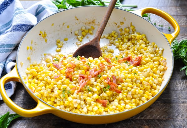 Horizontal shot of fried corn in a cast iron skillet