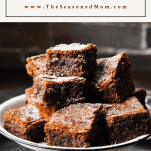 Front shot of a tray of homemade brownies with text title box at the top