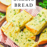 Front shot of garlic bread in a serving tray with text title box at the top