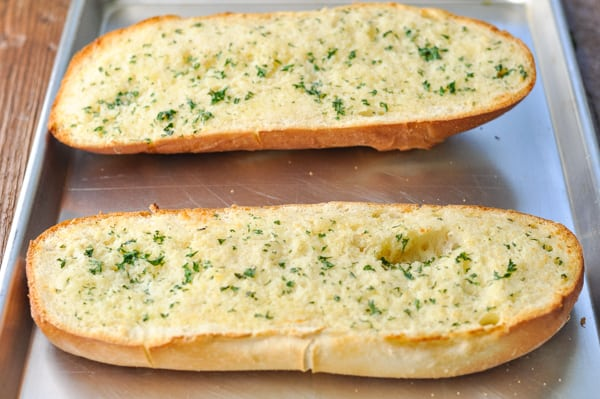 Toasted garlic bread on a baking sheet