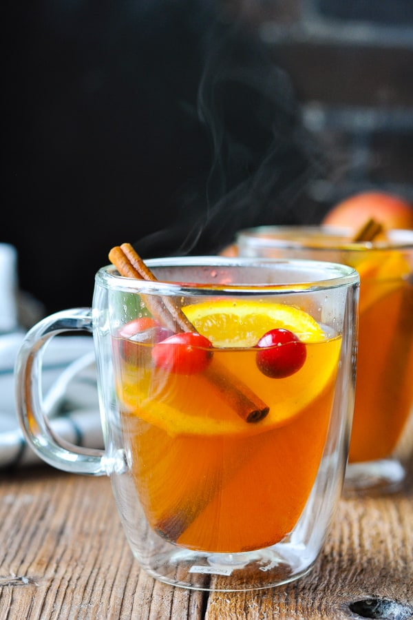 Mug of Wassail on a wooden table