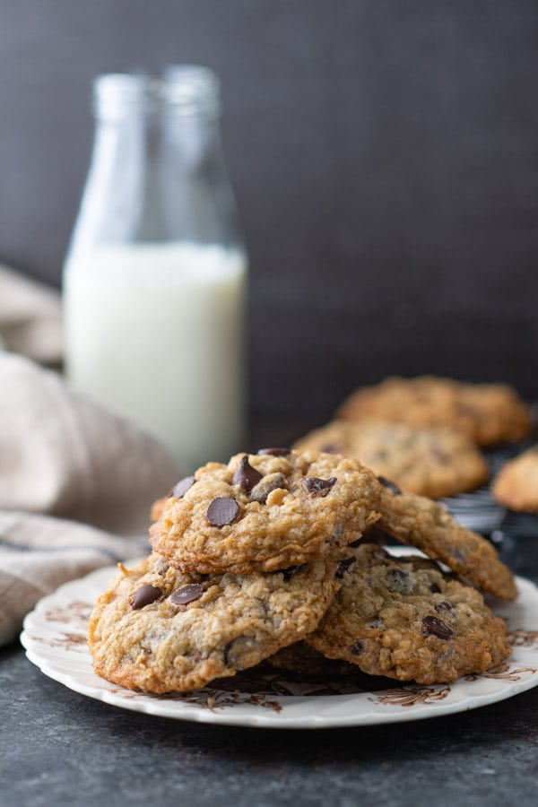 Side shot of a plate of soft and chewy oatmeal chocolate chip cookies
