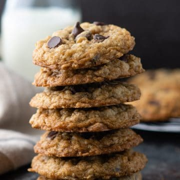 Close up shot of a stack of old-fashioned soft and chewy oatmeal chocolate chip cookies