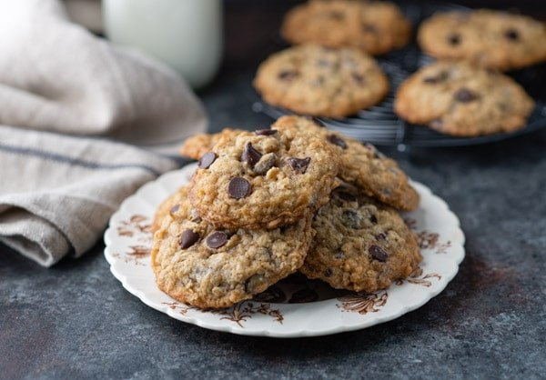 Horizontal shot of a plate of soft and chewy oatmeal chocolate chip cookies