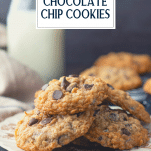 Side shot of a plate of soft and chewy oatmeal chocolate chip cookies with text title overlay