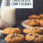 Oatmeal chocolate chip cookies on a cooling rack with text title overlay