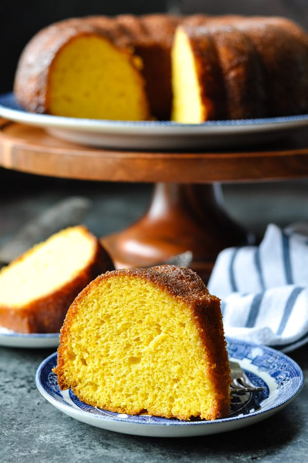 Slice of Amish Orange Juice Cake on a blue and white serving plate