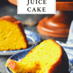 Close up shot of a slice of old fashioned orange juice cake on a blue and white plate with a fork and a text title at the top