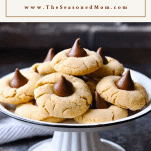 Front shot of a tray of peanut butter blossoms with text box at top