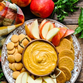 Overhead shot of harvest pumpkin dip tray on a wooden surface