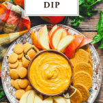 Overhead image of a tray of pumpkin dip with a text title at the top