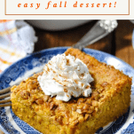 Side shot of pumpkin dump cake with a text title at the top