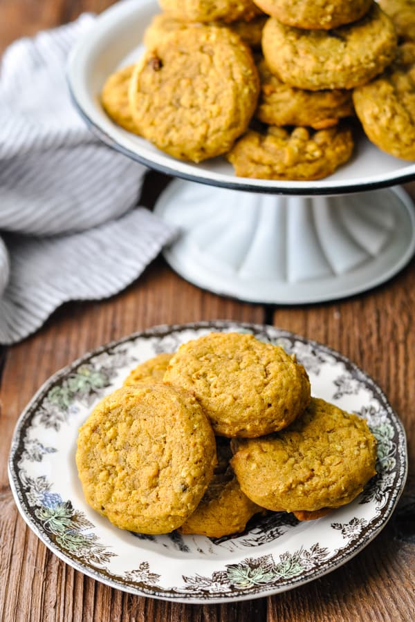 Overhead image of pumpkin cookies with oats and raisins on a wooden table