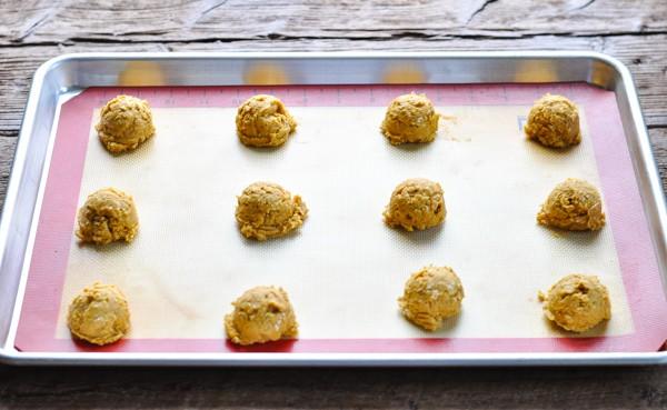 Pumpkin oatmeal cookie dough balls on a baking sheet