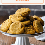Pumpkin oatmeal cookies on a cake stand with text title box at the top