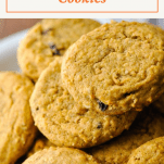Close up shot of a pile of pumpkin oatmeal cookies with a text title box at the top