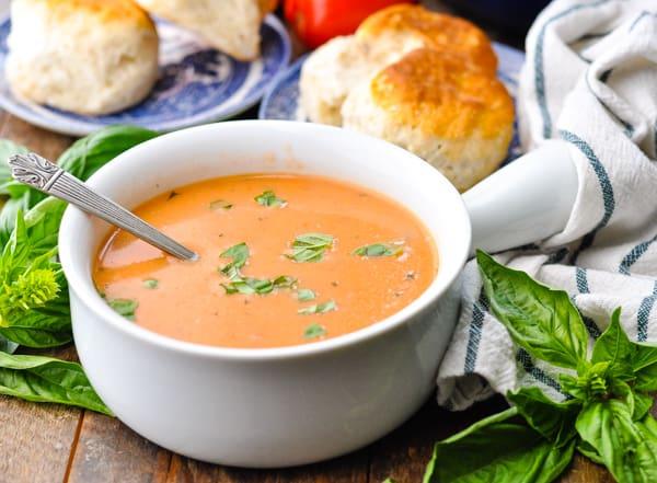 Horizontal shot of a bowl of creamy tomato soup
