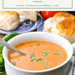 Bowl of roasted tomato soup with text title box at the top
