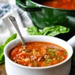 Front shot of a bowl of stuffed pepper soup garnished with parsley