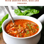 Front shot of a bowl of stuffed pepper soup with text title at the top