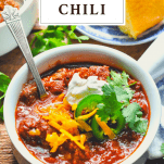 Front shot of a bowl of Texas Chili with a text title box at the top