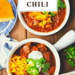 Overhead shot of two bowls of Texas Chili with a text title box at the top