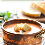 Bowl of easy tomato basil soup with a text title box at the top