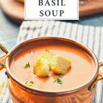 Bowl of homemade tomato basil soup with a text title box at the top