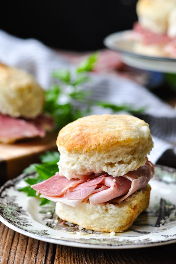 Front shot of a Virginia country ham biscuit on a small plate