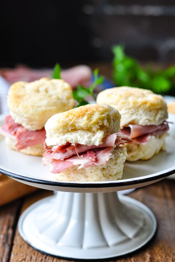 Tray of country ham biscuits with fresh parsley garnish