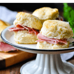 Serving tray full of Virginia Country Ham Biscuits with a text title box at the top