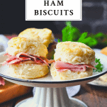 Serving tray full of country ham biscuits with text title box at the top