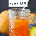 Jar of ginger pear jam on a wooden table with text title box at the top
