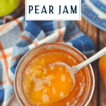 Overhead image of a spoon in a jar of pear apple and ginger jam