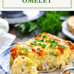 A baked western omelet on a blue and white plate with a text title box at the top