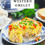Front shot of a slice of baked western omelet with text title box at top