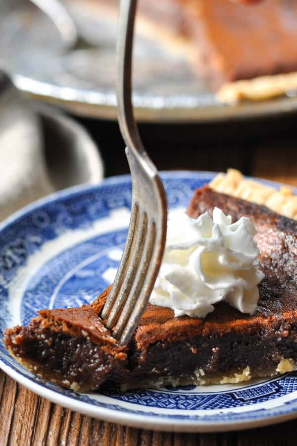 Fork digging into a slice of southern chocolate chess pie