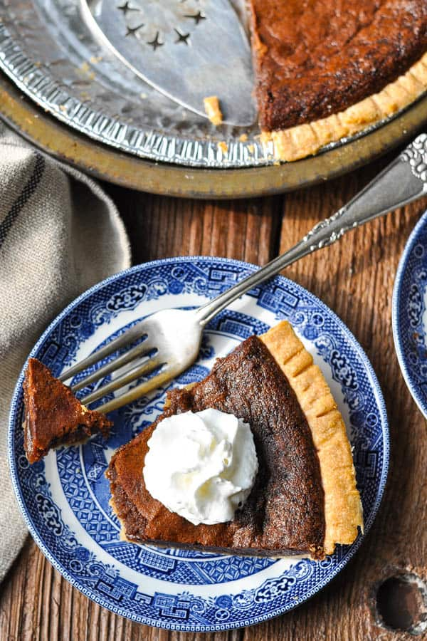 Overhead image of the best chocolate chess pie recipe on a wooden table