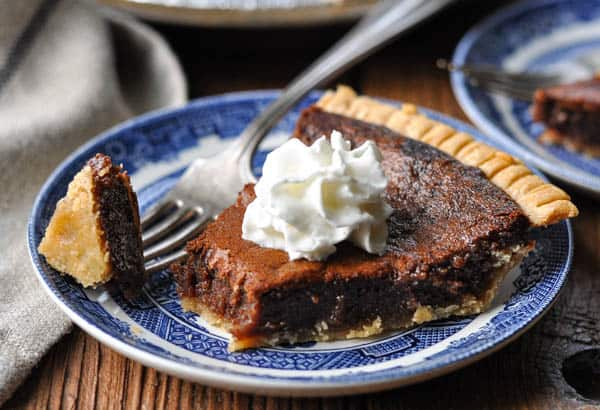Horizontal shot of a slice of easy chocolate chess pie recipe on a plate