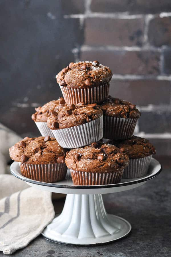 Front shot of a cake stand with a tower of double chocolate muffins