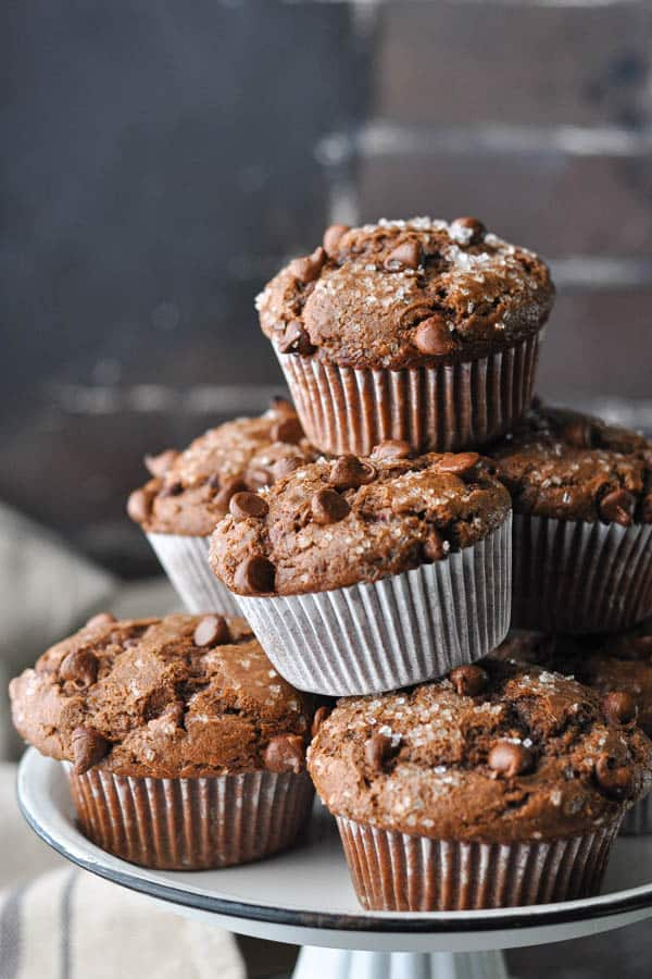 Close up side shot of a stack of homemade chocolate muffins from scratch