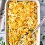 Overhead image of tuna noodle casserole with potato chips on a white surface