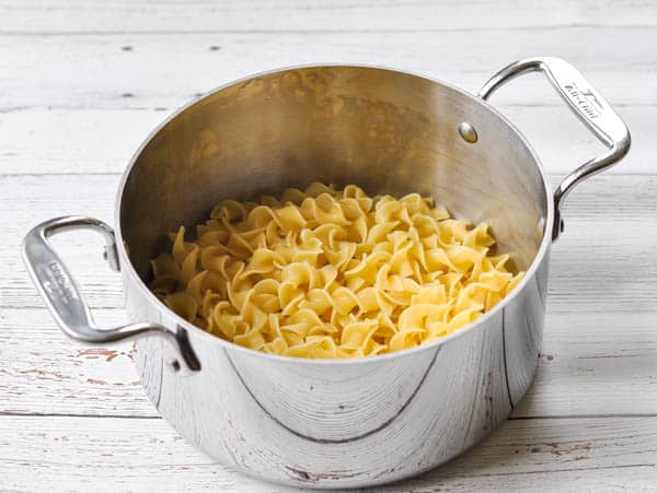 Pot of cooked egg noodles