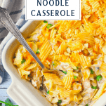 Overhead shot of Creamy Tuna Noodle Casserole in a dish with a text title box at the top