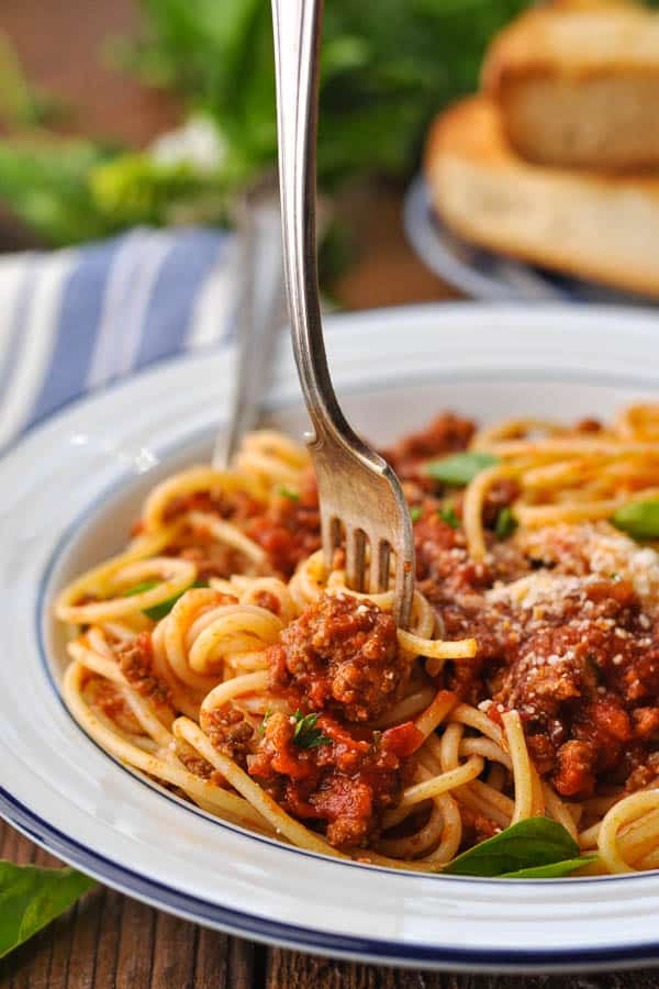 Fork twirling spaghetti with homemade sauce from the slow cooker