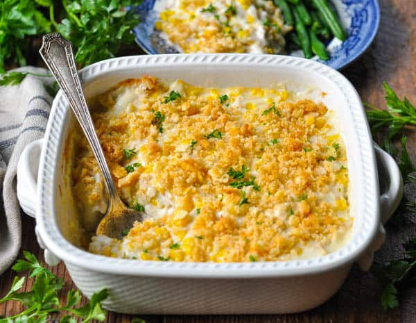 Horizontal shot of creamy chicken casserole recipe baked in a white dish