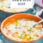 Spoon in a bowl of ham and bean soup with a text title box at the top