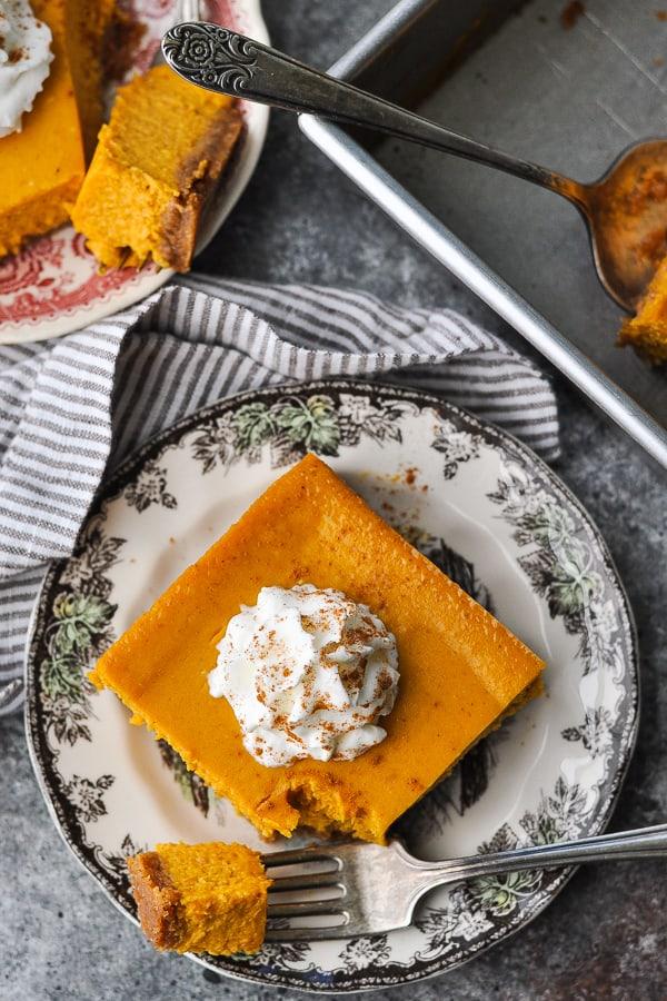 Overhead shot of a pumpkin cheesecake bar on a plate