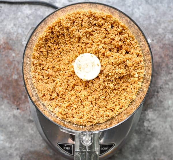 Graham cracker crumbs in a food processor