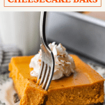 Fork eating a pumpkin cheesecake bar with a text title box at the top